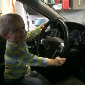 My son, a little excited to pretend drive it... He loves it already.