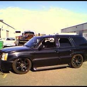 This is the truck when it was in the last couple of stages of being bagged with my old 2008 factory oem Escalade wheels powder coated black. Kind of m