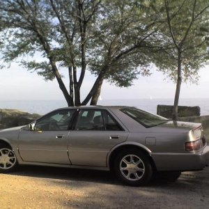 1997 Cadillac STS – Early fall in the parking lot by the lake shore