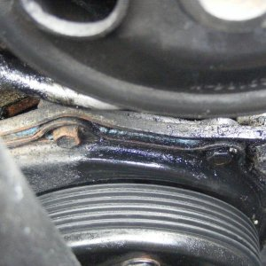timing cover between water pump and pw steering pulley