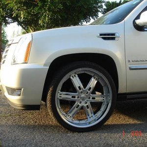Giovanna Barcelona 26 inch rims with custom painted white diamond insert.