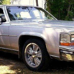 "The day I brought 'er home.  1988 Cadillac Brougham d' Elegance  $1600  Silver/Maroon 307 4-bbl 4 spd OD Stock except for the 17"" rims.  Drove li"